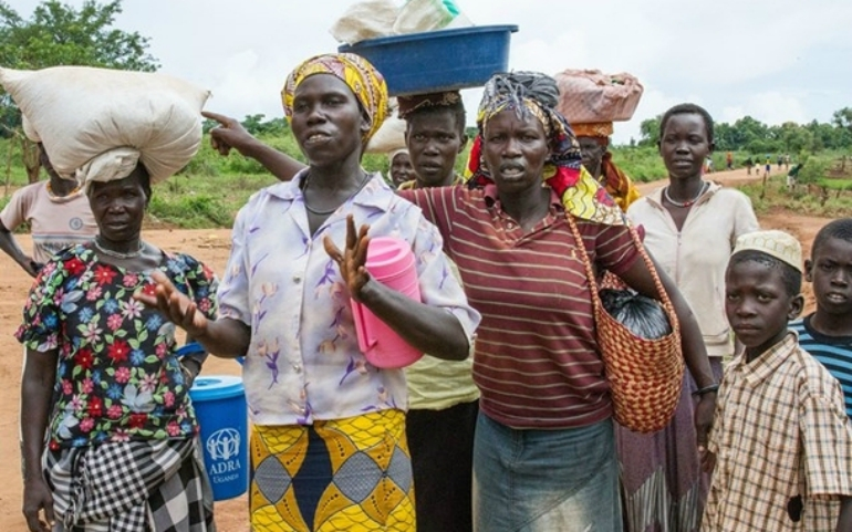 Women at the Bidi Bidi refugee settlement in Uganda in May 2017 voice their concern at the 50 percent cut in cereal rations each person was receiving. Photo credit: Coco McCabe/Oxfam